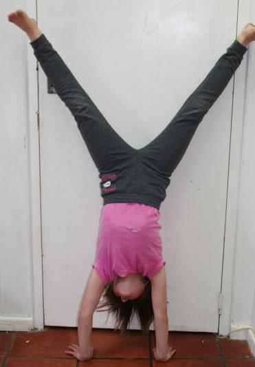 R-hand-stand-against-wall_1.jpg