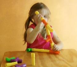 child-4y-9m-assembling-toy.jpg