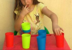 child-midline-crossing-moving-cups-1.jpg