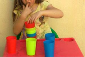 child-midline-crossing-moving-cups.jpg