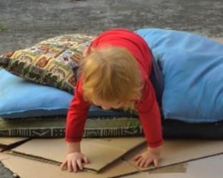 Crawling over Pile of cushions.jpg