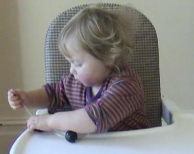 Lily 17months threading beads 1.jpg