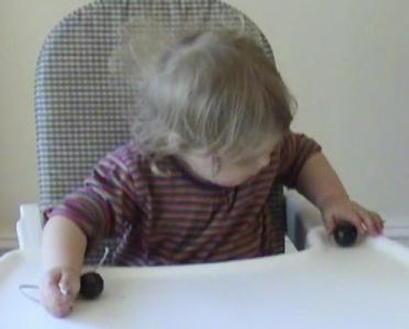 Lily 17months threading beads 2.jpg