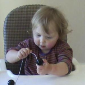 Lily 17months threading beads 3.jpg