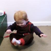 Iinfant scooting on buttocks
